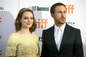 """Ryan Gosling, right, and Emma Stone arrive on the red carpet for the film """"La La Land"""" during the 2016 Toronto International Film Festival in Toronto on Monday, Sept. 12, 2016. (Chris Young/The Canadian Press via AP)"""
