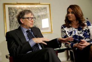 FILE - In this Monday, Feb. 22, 2016 file photo, Bill and Melinda Gates talk to reporters about the 2016 annual letter from their foundation, the Bill and Melinda Gates Foundation, in New York. Researchers are trying to infect mosquitoes in Brazil and Colombia with a type of bacteria that could prevent them from spreading Zika virus and other dangerous diseases. British and American governments are teaming up with the Bill and Melinda Gates Foundation and the U.K.-based Wellcome Trust to expand field tests in Rio de Janeiro in Brazil and the city of Bello in northwest Colombia, philanthropist Bill Gates told a conference Wednesday Oct. 26, 2016. (AP Photo/Seth Wenig, File)