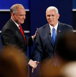Republican vice-presidential nominee Gov. Mike Pence, right, and Democratic vice-presidential nominee Sen. Tim Kaine shake hands after the vice-presidential debate at Longwood University in Farmville, Va., Tuesday, Oct. 4, 2016. (AP Photo/Steve Helber)