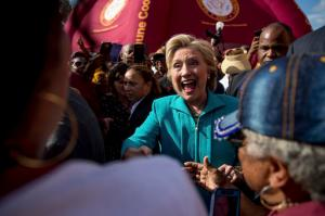 Democratic presidential nominee Hillary Clinton greets people at a homecoming tailgate for Bethune-Cookman University Wildcats as they take on the Delaware State Hornets in Daytona Beach, Fla., Saturday, Oct. 29, 2016. (AP Photo/Andrew Harnik)