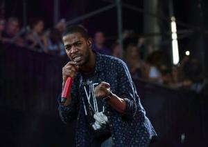 """FILE - In this Aug. 1, 2015, file photo, Kid Cudi performs at the Lollapalooza Music Festival in Grant Park in Chicago. The rapper announced on Facebook Oct. 4, 2016, that he had checked into rehab for """"depression and suicidal urges."""" (Photo by Steve C. Mitchell/Invision/AP, File)"""