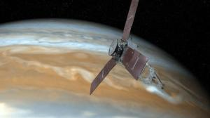 This undated artist's rendering shows NASA's Juno spacecraft making one of its close passes over Jupiter. NASA said Wednesday, Oct. 19, 2016, that the Juno spacecraft circling Jupiter went into safe mode, turning off its camera and instruments. The space agency said the Juno craft is healthy as engineers try to figure out what went wrong. (NASA via AP)