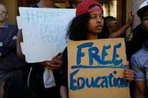 """Students from the University of Cape Town, UCT, protest on their campus demonstrating for free education  in Cape Town, South Africa, Monday, Oct. 3,  2016. A South African Education Minister Blade Nzimande said Monday a small minority of university students is trying to spread """"anarchy"""" with violent protests calling for free education. (AP Photo/Schalk van Zuydam)"""