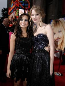 "FILE - In this April 2, 2009, file photo, Taylor Swift, right, and Demi Lovato pose together at the premiere of ""Hannah Montana the Movie"" in Los Angeles. Lovato announced on Twitter Tuesday, Oct. 4, 2016, that she's ""taking a break from music and the spotlight"" in the wake of criticism of her comments about Taylor Swift in a magazine interview. (AP Photo/Matt Sayles, File)"