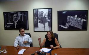 """FILE - In this Dec. 16, 2015 file photo, Josefina Vidal, Cuba's director-general of U.S. affairs, speaks to reporters beside Gustavo Machin, the deputy chief, backdropped by framed images of Cuba's President Raul Castro, from left, former Cuban leader Fidel Castro, and rebel leader Ernesto Che Guevara giving a speech at the United Nations in 1964, at the Foreign Ministry, in Havana, Cuba. Four months before President Barack Obama leaves office, a U.S. summer program for teens has provoked a full-blown backlash from the Cuban government. """"There's no place for these U.S. programs and they need to be eliminated in order for there to be normal relations,"""" Vidal, tweeted Friday, Sept. 30, 2016. (AP Photo/Desmond Boylan, File)"""