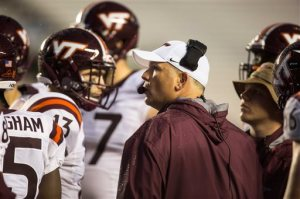 Virginia Tech head coach Justin Fuente speaks to his team during an NCAA college football game against North Carolina in Chapel Hill, N.C., Saturday, Oct. 8, 2016. (AP Photo/Ben McKeown)