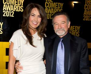 """FILE - In this April 28, 2013 file photo, Robin Williams, right, and his wife Susan Schneider Williams arrive to The 2012 Comedy Awards in New York. Schneider wrote an essay published in the medical journal, """"Neurology,"""" on Sept. 27, 2016, that Williams had """"chemical warfare in his brain"""" before his death. (AP Photo/Charles Sykes, File)"""