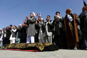 Afghans pray during the funeral of victim who died, a militant attack at a Shiite shrine in Kabul, Afghanistan, Wednesday, Oct. 12, 2016. An Afghan official say several people including a policeman were killed after a militant attack on a Shiite shrine in the capital Kabul late Tuesday. Sediq Sediqqi, the interior ministry's spokesman said Wednesday that another 62 people, including 12 policemen were wounded in the attack. (AP Photos/Rahmat Gul)