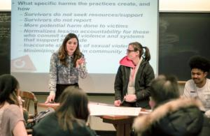 "In this April 8, 2016, photo provided by Breakthrough, Columbia University graduate student Savannah Badalich leads a Breakthrough Campus Catalyst Training with student activists at Syracuse University in Syracuse, N.Y., for Sexual Assault Awareness Month. When news broke that Donald Trump, the Republican nominee for president, had bragged of groping women, and then trivialized it as ""locker room talk,"" it felt to some students like a repudiation of their efforts. (Jacob Greenfield/Breakthrough via AP)"