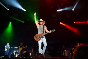 FILE - In this April 3, 2016, file photo, Kenny Chesney performs at the 4th Annual ACM Party for a Cause Festival at the Las Vegas Festival Grounds in Las Vegas. Chesney will receive the Pinnacle Award during the 50th annual Country Music Association Awards, joining Garth Brooks and Taylor Swift as the only recipients. The CMA Awards will air live from the Bridgestone Arena in Nashville on Nov. 2 on ABC. (Photo by Eric Jamison/Invision/AP, File)