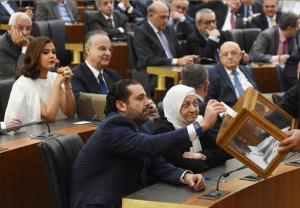 In this photo released by the Lebanese Parliament media office, former Lebanese Prime Minister and lawmaker Saad Hariri, center, casts his vote during a session to elect new president at the parliament hall, in Beirut, Lebanon, Monday, Oct. 31, 2016. Lebanon's parliament on Monday elected Michel Aoun, an 81-year-old former army commander and strong ally of the militant group Hezbollah, as the country's president, ending a more than two-year vacuum in the top post and a political crisis that brought state institutions perilously close to collapse. (Hassan Ibrahim, Lebanese Parliament media office, via AP)