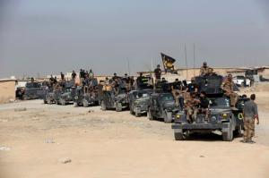 File -- In this Saturday, Oct. 15, 2016 file photo, Iraq's elite counterterrorism forces gather ahead of an operation to re-take the Islamic State-held City of Mosul, outside Irbil, Iraq. Iraqi forces appear poised to launch their most complex anti-IS operation to date: retaking the country's second largest city of Mosul. While the country's military has won a string of territorial victories that have pushed IS out of more than half of the territory the group once held, some Iraqi officials worry that the Mosul fight has been rushed and if the city is retaken without a plan to broker a peace, it could lead to more violence. (AP Photo/Khalid Mohammed, File)