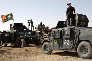 Iraqi special forces soldiers deployed for an offensive to retake Mosul from Islamic State militants prepare to move out from a camp near Khazer, Iraq, on Friday, Oct. 14, 2016. The US-led coalition says they are increasing airstrikes in and around the militant-held city of Mosul as Iraqi ground forces are building up ahead of a planned operation to retake the city. (AP Photo/Adam Schreck)