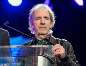 """FILE - In this Jan. 24, 2015 file photo, Harry Shearer appears at the 30th annual TEC Awards during the 2015 National Association of Music Merchants (NAMM) show in Anaheim, Calif. Shearer filed a lawsuit in a federal court in Los Angeles on Monday, Oct. 17, 2016, against the French studio Vivendi S.A. over profits from the 1984 hit """"This Is Spinal Tap"""" and its merchandise and music. (Photo by Paul A. Hebert/Invision/AP, File)"""