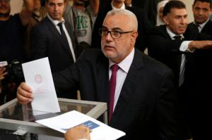 Prime Minister and leader of the Islamist Justice and Development Party, known as the PJD, Abdelilah Benkirane casts his ballot at a polling station for the parliamentary elections, in  Rabat, Morocco, Friday, Oct. 7, 2016. Millions of Moroccans hit the voting booths, with worries about joblessness and extremism on many minds as they choose which party will lead their next government.(AP Photo/Abdeljalil Bounhar)