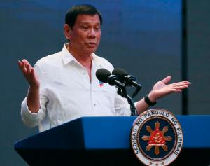 """Philippine President Rodrigo Duterte gestures during his address to a Filipino business sector in suburban Pasay city south of Manila, Philippines Thursday, Oct. 13, 2016. Duterte has been under criticism by international human rights groups, the United Nations, European Union and the United States for the more than 3,000 deaths of mostly suspected drug-users and drug-pushers in his so-called """"War on Drugs"""" campaign since assuming the presidency on June 30. (AP Photo/Bullit Marquez)"""