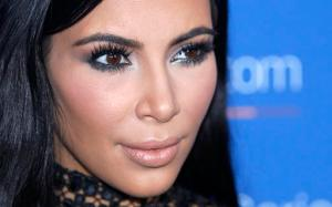 """FILE - In this June 24, 2015, file photo, Kim Kardashian West poses during a photo call at the Cannes Lions 2015. An online retailer has pulled a Halloween costume that made light of the recent jewelry heist involving Kardashian West. The costume prompted outrage from some social media users. The company's Twitter account announced Tuesday, Oct. 11, 2016, that the costume had been pulled and apologized if it """"offended anyone."""" (AP Photo/Lionel Cironneau, File)"""