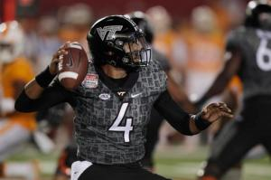 FILE - In this Sept. 10, 2016, file photo, Virginia Tech quarterback Jerod Evans looks to pass against Tennessee during the first half of an NCAA college football game at Bristol Motor Speedway, in Bristol, Tenn. Evans has thrown 13 touchdown passes with one interception entering Saturday's trip to No. 17 North Carolina. (AP Photo/Wade Payne, File)