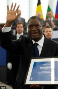 FILE - In this Wednesday Nov. 26, 2014 file photo, Doctor Denis Mukwege, from the Democratic Republic of Congo, a gynecologist who specializes in treating victims of rape and extreme sexual violence, waves as he gets the Sakharov Prize at the European Parliament in Strasbourg eastern France. Guessing the winner of the Nobel Peace Prize is notoriously hard because the secretive Norwegian Nobel Committee isn't dropping any hints, except that 376 people and groups have been nominated for the award, which will be announced on Oct. 10. That doesn't stop Nobel watchers from speculating, sometimes based on their own preferences or the small number of nominations that were made public by those who submitted them. Denis Mukwege, who has braved assassins' bullets to treat women brutalized in the country's long running civil war, is a perennial peace prize nominee.  (AP Photo/Christian Lutz, File)