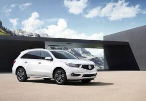 This undated photo provided by Honda shows the 2017 Acura MDX. Acura's most popular vehicle, the MDX luxury sport utility, has a more upscale look and more standard safety features for 2017. (Honda via AP)