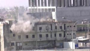 In this image made from video, smoke rises from a building where two militants are believed to be holed up, according to Rudaw TV, in Kirkuk, Iraq, Friday, Oct. 21, 2016. Militants armed with assault rifles and explosives attacked targets in and around the northern Iraqi city of Kirkuk early on Friday in an assault quickly claimed by the Islamic State group and likely aimed at diverting authorities' attention for the battle to retake IS-held Mosul. (Rudaw TV via AP)
