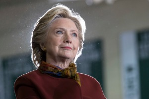 Democratic presidential candidate Hillary Clinton listens as vice presidential candidate Sen. Tim Kaine, D-Va. speaks during a campaign event at the Taylor Allderdice High School, Saturday, Oct. 22, 2016, in Pittsburgh, Pa. (AP Photo/Mary Altaffer)