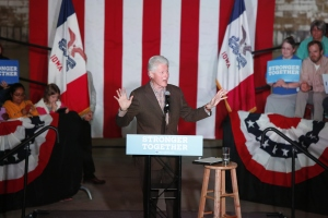 Former President Bill Clinton speaks on behalf of his wife Democratic presidential candidate Hillary Clinton on the National Cattle Congress grounds for a bus tour in Iowa, Wednesday, Oct. 12, 2016, in Waterloo, Iowa. (Matthew Putney/The Waterloo Courier via AP)