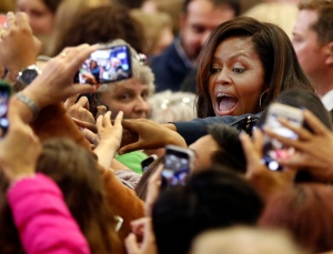 First lady Michelle Obama reaches out to shake hands during a campaign rally for Democratic presidential candidate Hillary Clinton Thursday, Oct. 13, 2016, in Manchester, N.H. (AP Photo/Jim Cole)