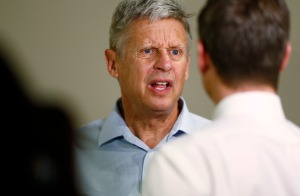 FILE - In this Oct. 3, 2016 file photo, Libertarian Presidential candidate Gary Johnson speaks during a news conference before a rally in Parker, Colo. The usual cohesion of voters in the conservative, Republican stronghold of Utah has been blown up this election season by Donald Trump's brashness and volatility, creating unprecedented uncertainty for a state that has been a shoo-in for GOP presidential candidates for a half century. (AP Photo/David Zalubowski, File)
