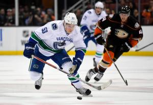 Vancouver Canucks center Bo Horvat, left, breaks away from Anaheim Ducks defenseman Cam Fowler on his way to a short handed goal during the first period of an NHL hockey game, Sunday, Oct. 23, 2016, in Anaheim, Calif. (AP Photo/Mark J. Terrill)