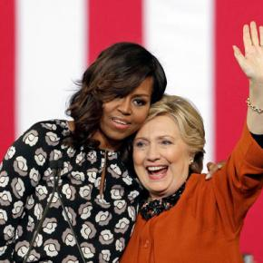 Trump hits 'corrupt' Hillary Clinton; Mrs. Obama hugs her