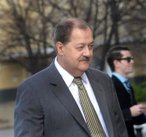 "FILE - In a Wednesday, April 6, 2016 file photo, former Massey CEO Don Blankenship is escorted by Homeland Security officers from the Robert C. Byrd U.S. Courthouse in Charleston, W.Va. Blankenship, who was sentenced to a year in jail and a $250,000 fine for his role in the Upper Big Branch Mine explosion,  has declared himself an ""American political prisoner"" on his blog, blaming others for the 2010 mine explosion that killed 29 men and led to the former West Virginia coal operator's imprisonment. The ex-Massey Energy CEO said he plans to distribute 250,000 copies of the 67-page diatribe in booklet form.  (F. Brian Ferguson/Charleston Gazette-Mail via AP, File)"