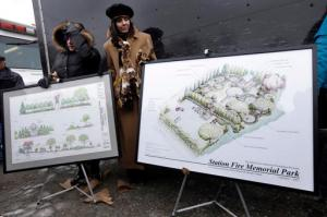 File - In this Sunday, Feb. 17, 2013, file photo Diane Gomes, of Johnston, R.I., left, and Elaine Grant, of Lincoln, R.I., center, display artist's renderings of a planned permanent memorial for victims of The Station nightclub fire, a blaze that claimed the lives of 100 people, during ceremonies at the site of the fire, in West Warwick, R.I. Organizers of the effort to build a permanent memorial at the site of the February 2003 blaze at the Station nightclub in Rhode Island announced Monday, Oct. 17, 2016, that they have achieved their $2 million fundraising goal. (AP Photo/Steven Senne, File)
