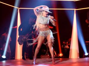"""This Oct. 22, 2016 photo released by NBC shows Lady Gaga performing on """"Saturday Night Live,"""" in New York. Lady Gaga released her latest album, """"Joanne,"""" on Friday. (Will Heath/NBC via AP)"""