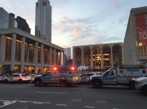 "Police respond to New York's Metropolitan Opera which halted a performance after someone sprinkled an unknown powder into the orchestra pit, Saturday, Oct. 29, 2016. Met spokesman Sam Neuman said the afternoon's performance of ""Guillaume Tell"" was canceled during the second intermission after the person sprinkled the powder into the pit from the orchestra section. A police spokeswoman said the person who sprinkled the powder fled and was being sought. (Dylan Hayden via AP)"
