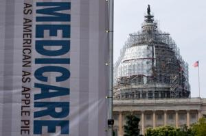 FILE - In this July 30, 2015 file photo, a sign supporting Medicare is seen on Capitol Hill in Washington. Medicare on Friday, Oct. 14, 2016, unveiled a far-reaching overhaul of how it pays doctors and other clinicians. Compensation for medical professionals will start taking into account the quality of service, not just quantity. (AP Photo/Jacquelyn Martin, File)