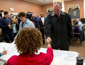 Democratic vice presidential candidate US Sen. Tim Kaine, D-Va., and his wife, Anne Holton greet poll workers as they prepare to vote in Richmond, Va., Tuesday, Nov. 8, 2016. (AP Photo/Steve Helber)