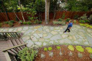In this photo taken Tuesday, Aug. 23, 2016, city water resources specialist Randy Barron walks through a low water use garden in the backyard of a Lomita Heights home in Santa Rosa, Calif. California water agencies that spent more than $350 million in the last two years of drought to pay property owners to rip out water-slurping lawns are now trying to answer whether the nation's biggest lawn removal experiment was all worth the cost. (AP Photo/Eric Risberg)