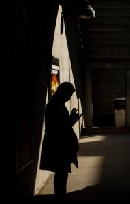 FILE - In this Wednesday, Oct. 12, 2016, file photo, moments before boarding an arriving train to Manhattan, a morning commuter uses his smartphone on the platform of the Long Island Rail Road at the Bayside Station in the Queens borough of New York. TVs are so last century. News outlets are using Facebook Live, Snapchat, YouTube and other tools to offer live coverage of Election Day in ways not possible four years ago. (AP Photo/Alexander F. Yuan, File)