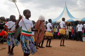 """In this photo taken Saturday, Nov. 5, 2016, girl dancers perform at an Ana Taban, or """"I am tired"""" artists movement roadshow, in Juba, South Sudan.  For many in South Sudan, the arts have become a rare haven of peace in a young country that has known little but years of civil war. (AP Photo/Justin Lynch)"""