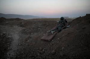 A Kurdish Peshmerga soldier overlooks Islamic State positions in Bashiqa, east of Mosul, Iraq, Monday, Nov. 7, 2016. Iraqi Kurdish fighters are exchanging heavy fighters with militants as they advance from two directions on a town held by the Islamic State group east of the city of Mosul. (AP Photo/Felipe Dana)