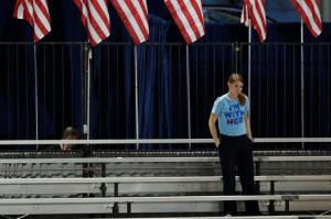 A Clinton supporter stands alone in the bleachers after Democratic presidential nominee Hillary Clinton's election night rally was canceled at the Jacob Javits Center in New York, Wednesday, Nov. 9, 2016. (AP Photo/Patrick Semansky)