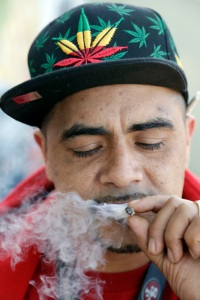Armando Rodriguez, who smokes marijuana for recreational and medicinal purposes, smokes Wednesday, Nov. 9, 2016, in San Francisco. Prop 64 legalizing marijuana for recreational use passed in California. The number of Americans living in states with recreational marijuana more than tripled after at least three states voted to fully legalize the drug. (AP Photo/Marcio Jose Sanchez)