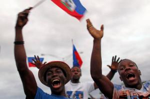 Supporters of presidential candidate Maryse Narcisse rally in Port-au-Prince, Haiti, Friday, Nov. 18, 2016. Sunday's voters will choose a new president, with the top two finishers going to a Jan. 29 runoff, as well as senators and members of the Chamber of Deputies. (AP Photo/Ricardo Arduengo)