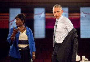 FILE - In this June 1, 2016, file photo, President Barack Obama removes his suit coat as he participates in a televised town hall event at Lerner Theatre in Elkhart, Ind., with PBS NewsHour co-anchor and manager editor Gwen Ifill, left. Ifill died on Monday, Nov. 14, 2016, of cancer, PBS said. She was 61.  (AP Photo/Pablo Martinez Monsivais, File)