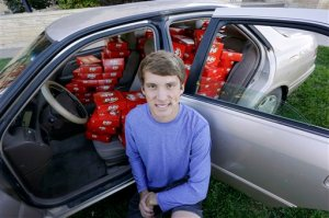 IMAGE DISTRIBUTED FOR THE HERSHEY COMPANY - Hunter Jobbins, freshman at Kansas State University, poses with his car filled with nearly 6,500 Kit Kat bars on Thursday, Nov. 3, 2016, in Manhattan, Kansas. Earlier this week, Jobbins had a Kit Kat bar stolen from his unlocked car and a mysterious note was left from the thief. (Colin E. Braley/AP Images for The Hershey Company)