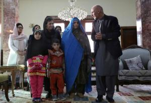 "Afghan President Ashraf Ghani, right, poses for photographers during a meeting with National Geographic's famed green-eyed ""Afghan Girl,"" Sharbat Gulla, and family, at the Presidential palace in Kabul, Afghanistan, Nov. 9, 2016. Afghanistan's president on Wednesday welcomed home Gulla who was deported from Pakistan after a court had convicted her on charges of carrying a forged Pakistani ID card and staying in the country illegally. (AP Photo/Rahmat Gul)"