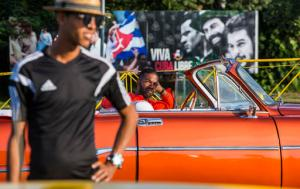 Drivers wait for tourists, in vintage American convertibles at Revolution Square in Havana, Cuba, Sunday, Nov. 27, 2016. Cuba's government declared nine days of national mourning after Cuban leader Fidel Castro died Friday and this normally vibrant city has been notably subdued. As Cuba prepares a massive commemoration for Castro, tens of thousands of high-season travelers have found themselves accidental witnesses to history and in the middle of a somber city that's little like its usual exuberant self.  (AP Photo/Desmond Boylan)