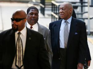 """Bill Cosby, right, arrives for a hearing in his sexual assault case at the Montgomery County Courthouse on Tuesday, Nov. 1, 2016, in Norristown, Pa. Prosecutors at the pretrial hearing on Tuesday will ask the judge to let the other accusers testify to show Cosby drugged and molested young women in a """"signature"""" fashion. (AP Photo/Mel Evans)"""