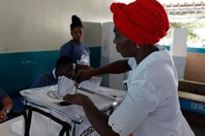 A woman casts her ballot in the Petion-Ville suburb of Port-au-Prince, Haiti, Sunday, Nov. 20, 2016. Haiti's repeatedly derailed presidential election got underway more than a year after an initial vote was annulled.  (AP Photo/Ricardo Arduengo)